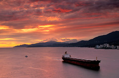Cargo to Vancouver ((nz)dave) Tags: ocean light sunset red orange canada color colour beautiful up vancouver buildings atardecer golden amazing zonsondergang nikon tramonto ship sonnenuntergang shot gorgeous cargo handheld 1755mmf28g burrardinlet nikkor puestadelsol motoring coucherdusoleil d300 atsunset  interestingness7 bristishcolumbia 5photosaday nikoncapturenx argyleavenue borrowlenses sooryasta explore08mar2009