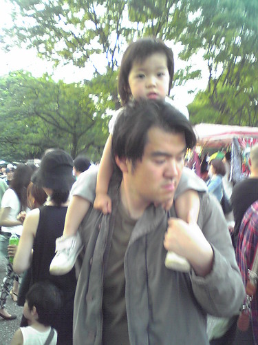 Cute little girl carried by her dad