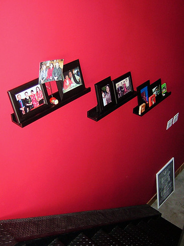 red wall with photos