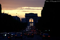 Champs Elyses (Hylda_H) Tags: road city travel trees sunset urban black trafficlights paris france color history cars beauty leaves night outdoors photography gold grey lights europe flickr cityscape arch fotografie shadows traffic flag gray silhouettes illumination landmark foliage frankrijk inverted parijs larcdetriomphe tricolore lacit champselyse beautyisintheeyeofthebeholder hyldah