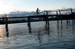 Cycling Over Bridge Hurt by Latest Hurricane in Madagascar (Grace's clicks) Tags: africa bridge blue sunset bicycle damaged madagascar hurricanedestruction lpdamaged