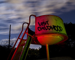 Lost Childhood (Lost America) Tags: lightpainting abandoned playground night clouds hospital slide urbanexploration ue urbex decommissioned oakknollnavalhospital