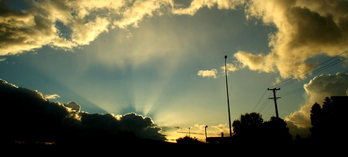 Sun rays over the orange clouds