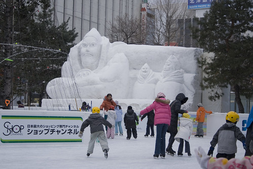 ice skaters and snow sculpture