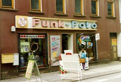 Konsum Photographic shop, Zeulenroda  July 1993 (sludgegulper) Tags: shop foto front laden funk konsum zeulenroda geschaeft fotohaus