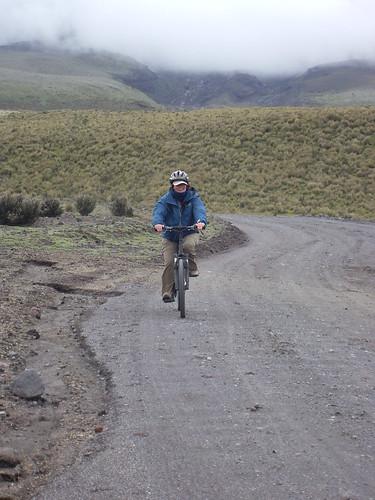 Kathy biking down the Volcano