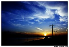 March 2009 Sunset (Tansan) Tags: blue sunset sky cloud sun clouds river landscape formation lamppost flickrsbest ysplix