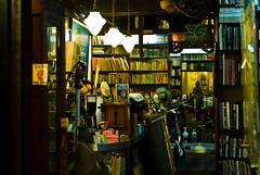 the Afghan Girl in the second-handed book store (summerrunner) Tags: city people cinema glass night 35mm book spring nikon flickr dof snapshot taiwan scene explore adobe april taipei nikkor 2009 生活 lightroom explored d80 嗯