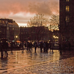 Parvis de Notre Dame at Sunset ~ Rita Crane Photography:  France / Paris / people / rain / reflection / umbrellas / street / building / photography / silhouette / notre dame / sunset  colors (Rita Crane Photography) Tags: sunset people urban paris france rain silhouette architecture reflections stock streetphotography notredame umbrellas urbanlandscape stockphoto tms iledelacite 500x500 tellmeastory eveningcolors glowingcolors iloveparis placeduparvisnotredame mywinners rosysunset aplusphoto wwwritacranestudiocom parvisnotredame