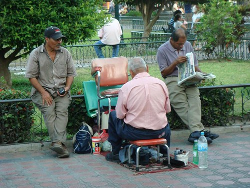 Shoeshine men in Tampico, Mexico.