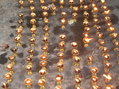 Butter Candles at the Temple (mccannmitchell) Tags: nepal light mountains love yellow temple happy fire gold lights candles buddhist magic traditional prayer joy dream sacred ritual kathmandu lamps spiritual tranquil himalayas blessed enchanting auspicious swayambhunath hypnotising revered