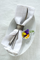 a simple setting (mwhammer) Tags: flowers soft sweet napkin details knife fork whites greetings elegant delicate simple pansies placesetting overhead gestural edibleflowers melinahammer foodandpropstyling
