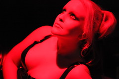 Redlight lady (IMG_2836) (One Finger Snap) Tags: red portrait woman lady female fetish contrast pose geotagged lights costume colours shadows creative highcontrast dungeon rubber bdsm latex corset nophotoshop mistress primary submissive assistedsuicide canonef100mmf28macrousm onefingersnap