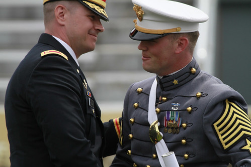First captain gets congrats after receiving his diploma by West Point Public Affairs.