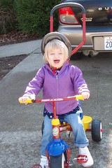 testing out her new tricycle