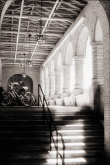 Flagler College Bicycles (Jamie Powell Sheppard) Tags: blackandwhite bw art film architecture ir photo florida fineart bikes arches bicycles canonae1program staugustine flaglercollege sepiatone colonnade henryflagler 50mmlens 35mmslr femalephotographer poncedeleonhotel hc110dilb 29darkredfilter kodakhiebwinfrared subthiaps