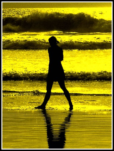 Woman Walks By the Sea