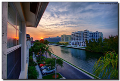Easter Sunday's Sunset (Fraggle Red) Tags: blue sunset orange yellow clouds canal florida balcony handheld hdr aventura canonefs1022mmf3545usm 3exp anawesomeshot miamidadeco dphdr villagebythebay theviewlookingwest