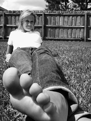 Toes (Brenna Noel) Tags: white black macro classic feet girl grass fence pose backyard toes photoshoot perspective jeans bestfriend chill laidback greyscale relazed