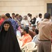 A woman searches for relatives at a prisoner release ceremony held at the Um al-Qura mosque.