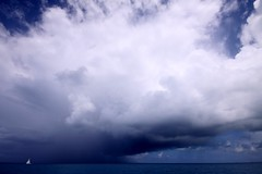 How fragile we are (photocillin) Tags: blue sky cloud seascape storm scale rain squall skyscape boat sailing escape yacht horizon small wideangle running tiny sail fragile enormous sooc nokeh