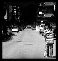 Girl playing 'Mom' (michalis melas) Tags: bw baby playing girl happy day mother like mothers acting picnik michalis melas  michalismelas