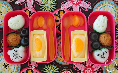 Shaped egg, hush puppy, olives, shaped rice, yogurt, mandarin oranges