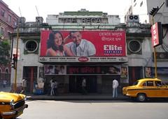 The Regal Cinema - Kolkata Calcutta, India (John Meckley) Tags: india cinema film yellow architecture movie asian hall theater treasure theatre taxi indian billboard kolkata calcutta regal bsnl portholes westbengal yellowtaxi greem bablu theregal cinemahall cinemedia elitefootware