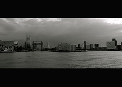 Skyline of Rotterdam (Roy G.) Tags: blackandwhite bw panorama skyline rotterdam maas willemsbrug erasmusbrug unilever dehef zwartenwit canonpowershotg9