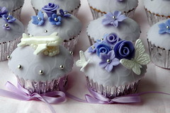 Wedding cupcakes for the bride and groom (creativecupcakes) Tags: wedding roses white silver airplane groom bride purple blossoms lavender butterflies cupcake fondant dragees