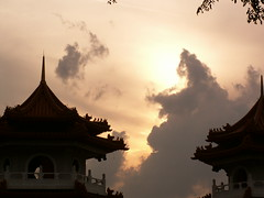 Temple Tops (sparkeypants) Tags: travel sunset sky favorite cloud building silhouette clouds canon geotagged temple singapore asia darkness rooftops calm roofs favourite platinumheartaward perfectsunsetssunrisesandskys earthasia chineseandjapanesegardens lpsky lpgoldenhour