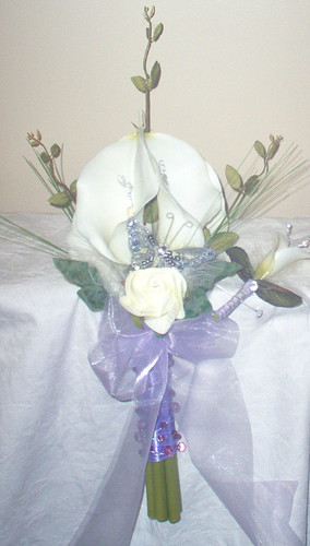 *zara 323 po* a brides calla lily hand held bouquet with roses/fetshers leaves/grasses/butterfly and complimenting grooms buttonhole by you.
