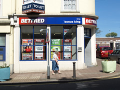 Betfred (chrisinplymouth) Tags: door uk england people gambling shop corner unitedkingdom plymouth pedestrian doorway devon betting bookmakers stoke shopfront bookies galleried plymgrp cw69x chrisinplymouth