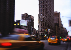 Flatiron Building at Rush Hour, New York City (andrew c mace) Tags: new york city nyc newyork motion blur building film day cityscape manhattan cab taxi broadway 4x5 flatiron largeformat cambo provia100 nikoncapturenx 81bfilter nikkor75mm 45sf