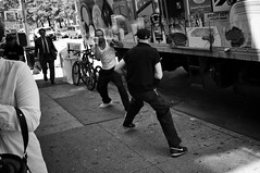Face off (syphlix) Tags: street bw eastvillage truck concrete fight candid suit fists stmarks wifebeater 3rdave