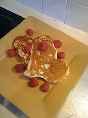 Raspberries and heart shaped pancakes for breakfast