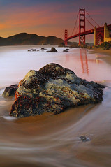 Marshalls Beach Glow, the Golden Gate Bridge - San Francisco, CA (kendra just is) Tags: sanfrancisco california longexposure bridge beach nikon rocks wave goldengate mussels d300 longexposures mytiluscalifornianus waveexposure