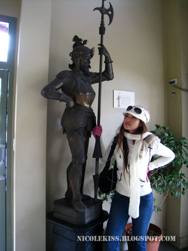 posing with statue