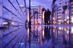 hazard (maybemaq) Tags: blue light lebanon reflection water evening seaside couple tide symmetry shore handrail beirut reflexions breathtaking hazard anxiety hightide waterreflection nighwalk colourartaward mirrorser