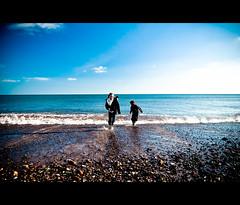 ~ Run Or Get Wet ~ (Komatoes) Tags: uk blue sea sky sun beach water clouds photography photo sand nikon waves stones picture 123 pebbles explore devon photograph foam dawlishwarren d40 whereareyounomoreposts