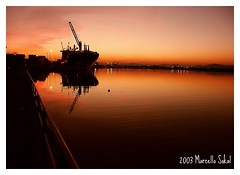 END OF THE DAY AT THE ITAJA PORT... (msokal) Tags: sunset sun port river ship minolta porto dimage itaja 7i