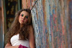 Miss V (citygirlny10305) Tags: pink blue portrait white building girl beautiful metal wall hair model focus rust paint pretty industrial dof child longhair makeup warehouse attitude curly blond tanktop teenager eyeshadow 13 thirteen selective pealing waivey