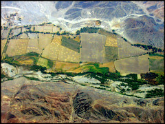 Just hanging around above the valley... (Now and Here) Tags: above mountains green peru up canon river airplane landscape town fb pueblo vertigo aerial powershot explore valley fields farms plain birdseyeview ica nazca a85 mostviewed nasca fincas canonpowershota85 fave10 explore53 fave50 fave25 nowandhere davidfarrant
