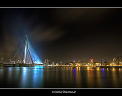 Rotterdam By Night - 2 (DolliaSH) Tags: city longexposure bridge light urban haven holland color water colors architecture night reflections river puente photography lights noche photo rotterdam europe foto nightshot photos nacht harbour tripod nederland thenetherlands wideangle ponte explore most le pont brug maas brcke ultrawide nuit kopvanzuid 2009 notte stad 1022 erasmusbrug noch zuidholland brucke erasmusbridge southholland nachtopname canoneos50d overtheexcellence dollia dollias sheombar