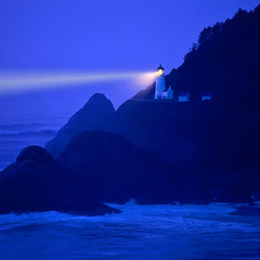 "Lighthouse beams across stormy night sea - Heceta Head, Oregon Coast (IronRodArt - Royce Bair (""Star Shooter"")) Tags: ocean blue light sea sky lighthouse house seascape water lamp rock night oregon warning point hope star coast harbor goal twilight marine waves sailing shine pacific harbour dusk head guidance faith guard scenic rocky belief stormy landmark security beam achievement shore maritime believe coastline safe guide nautical rough conceptual scape naval reward optimism protection beacon shining promise navigation ambition seas protect navigate guiding heceta beaming immovable warn steadfast achieve 10faves 25faves platinumheartaward redmatrix"