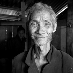 I am here (NaPix -- (Time out)) Tags: old portrait bw man black 6x6 face canon square happy asia vietnam explore soul spiritual emotions sapa hmong animism 500x500 explored napix