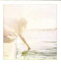 home (fivefortyfive) Tags: light sun film water girl polaroid sx70 person bay 600 overexposed sorta carlyn fivefortyfive cheeseballireallyreallyneedtomodifymycamera ihadtoeditthisabittomakeitseeable ifeelsinfuleditingapolaroid maggieannre