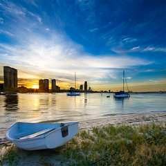 broadwater (Pawel Papis Photography) Tags: blue sunset sky beach water grass yellow clouds reflections evening bay boat sand raw yacht australia calm queensland yachts dri buldings goldcoast broadwater littleboat sigma1020 canon400d vertorama