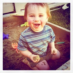 He is in heaven in the sandbox.