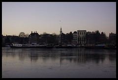 Amsterdam on a cold January morning (sublyro) Tags: winter ice amsterdam sunrise boat canal frozen ship thenetherlands houseboat wintertime 2009 canalhouses